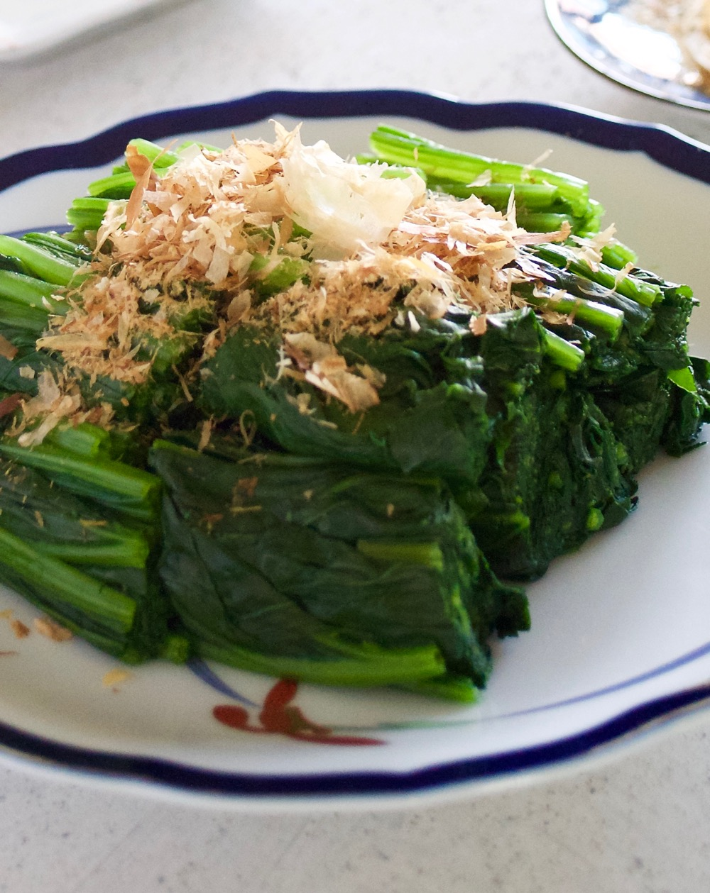 Spinach ohitashi salad is a very simple dish as a side or substitute for salad. Simply boil and serve with bonito flakes topping, or sesame seeds if vegetarian.