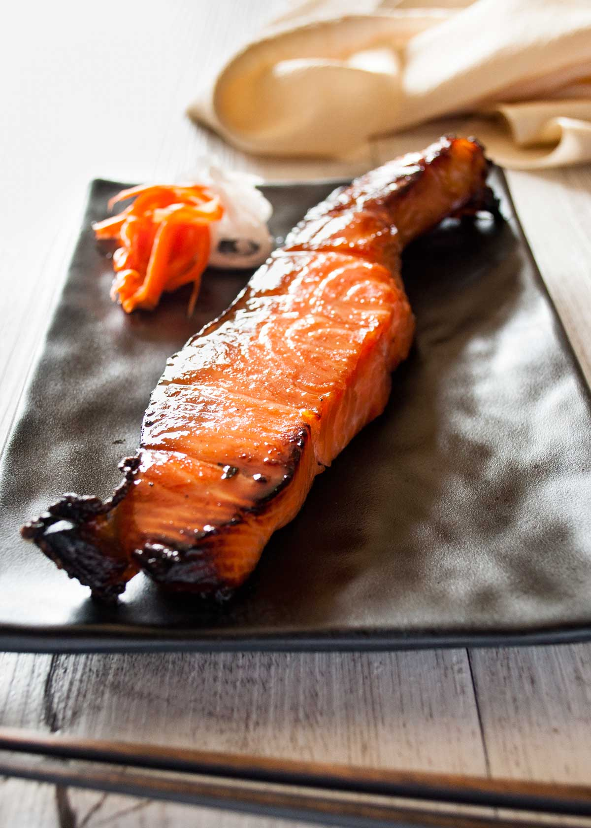 Japanese Salmon (Mirinzuke) - Simply marinating salmon with mirin, soy sauce and sugar will transform the salmon to a different level. All you need is time to marinate. The grilled salmon mirin-zuke is yummy even when it's cold. http://japan.recpetineats.com