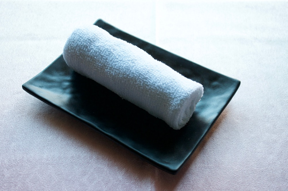 Oshibori (wet towel) to clean your hand before the meal.