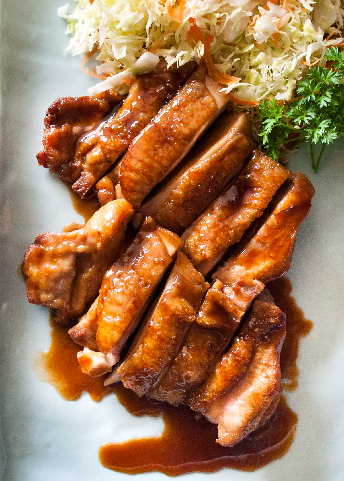 The very popular Japanese dish, Teriyaki Chicken is so easy to make. The sauce is just a mixture of soy sauce, sake, mirin and sugar. You don't even marinate the chicken. Sauté the chicken, add the sauce and it's all done!
