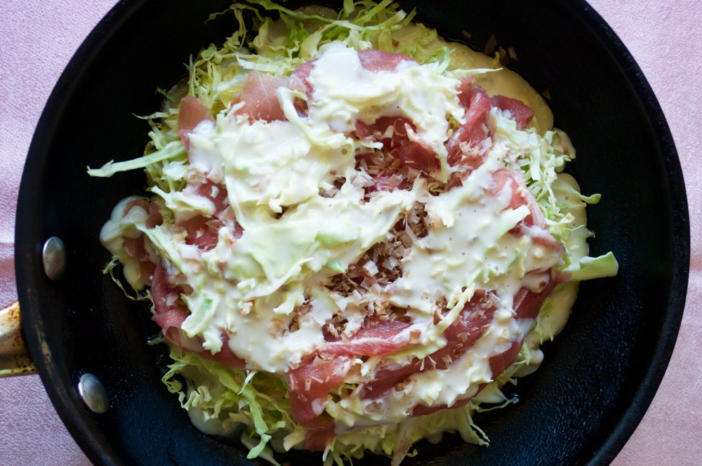 Okonomiyaki can be cooked in a fry pan.