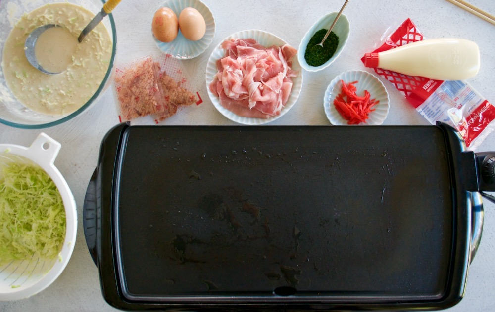 Electric teppanyaki plate and okonomiyaki ingredients