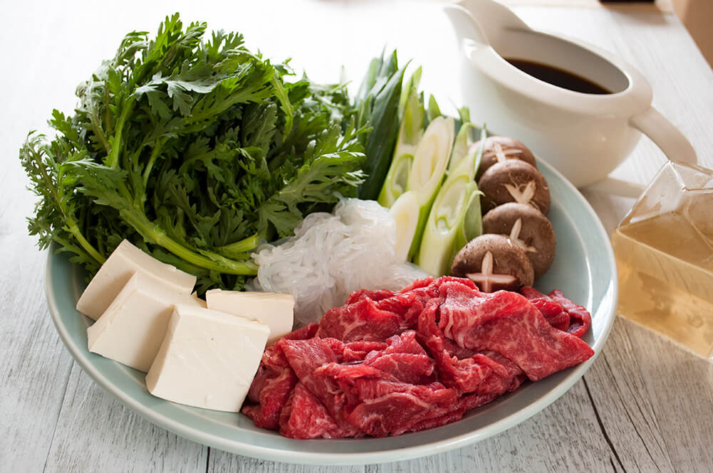 One of the most popular Japanese hot pot dishes, sukiyaki (すき焼き) is great for get-together with friends and family. Cooking thinly sliced beef, tofu and vegetables in sweet soy sauce flavour over a portable cooktop on the table is so much fun. It is quick to prepare and so tasty.
