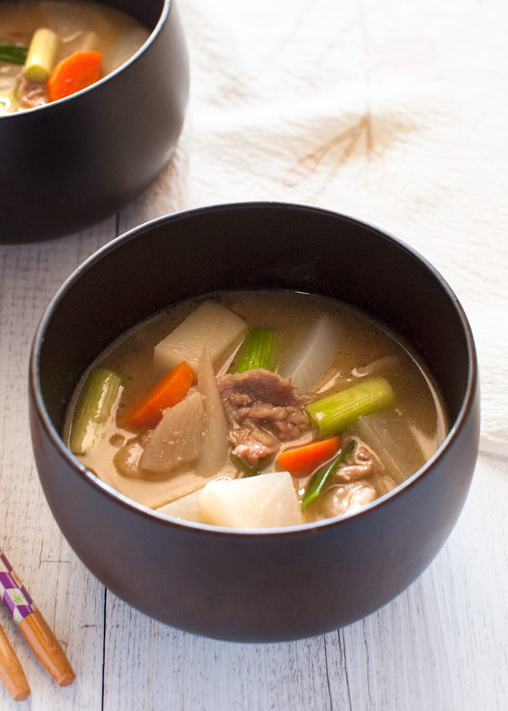 Tonjiru (豚汁) is a hearty miso soup with pork slices and vegetables ...