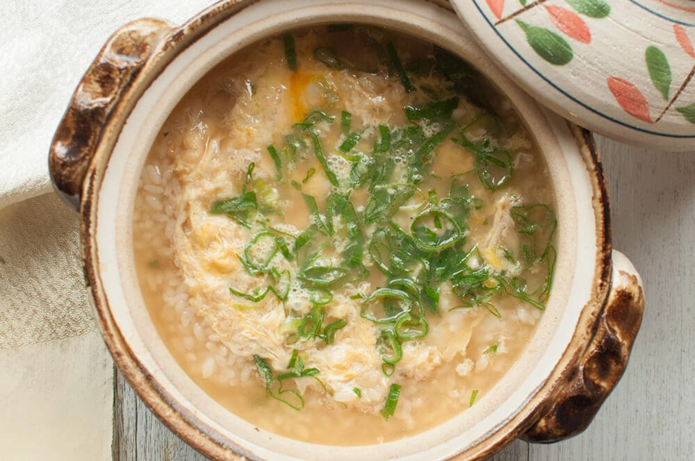 Zosui (雑炊) is a Japanese version of congee. Rice is cooked in flavoured soup with vegetables, egg and sometimes meat or fish. It is often made using the soup from the hot pot to wrap up the wonderful meal of the day. You can imagine how good the soup from the hot pot would be, can't you?