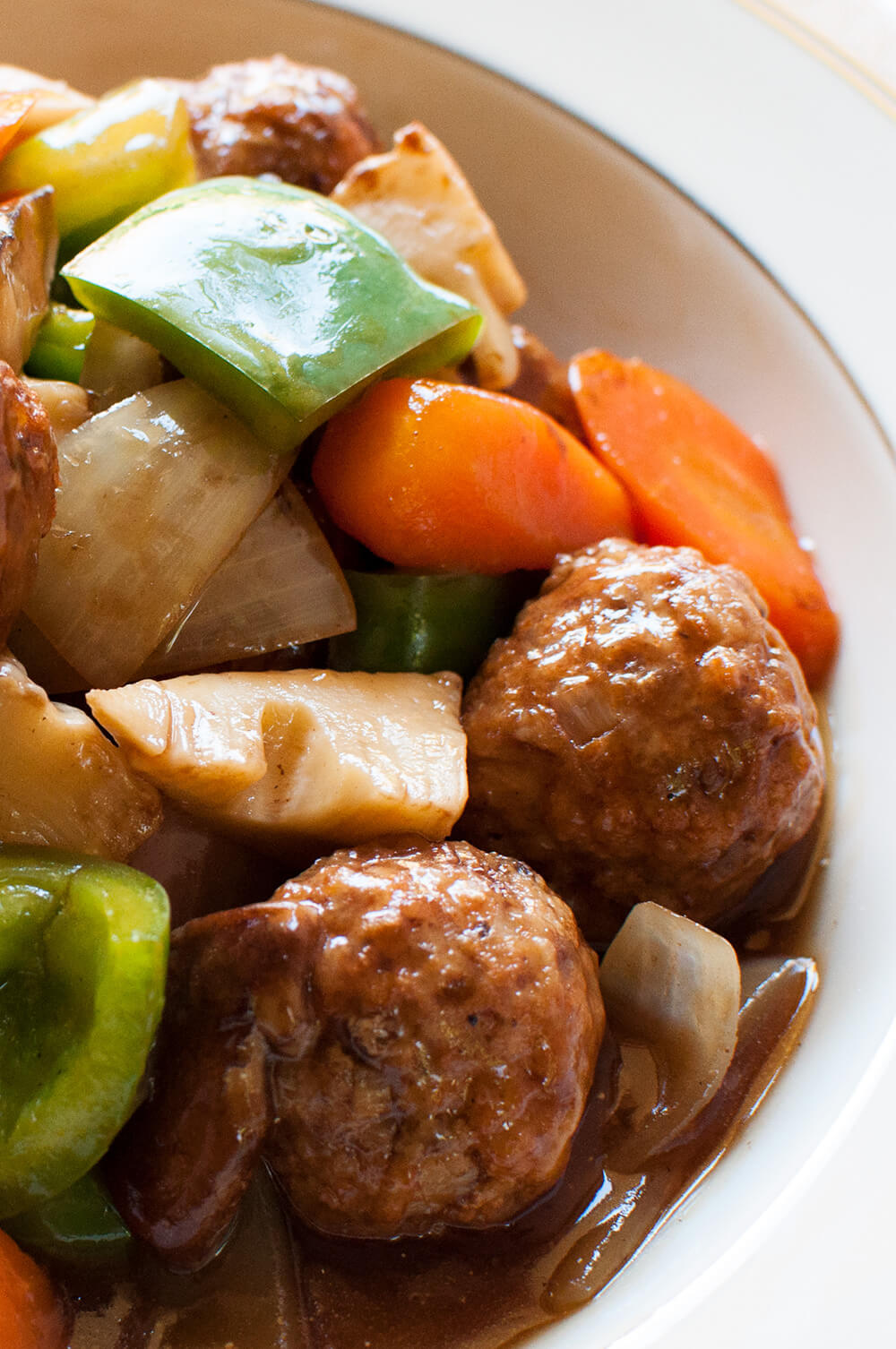 Sweet and sour pork usually uses cubed pork but this is a meatball version of sweet and sour pork. Onions in the meatballs give the meat more flavour and the sauce is not as strong as original Chinese sweet and sour pork.