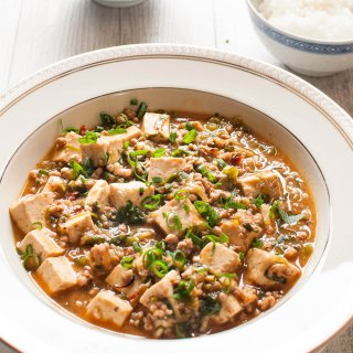 "Mabodofu (麻婆豆腐) is the Japanese name for ""Mapo Tofu"", which is a Chinese dish from Sichuan province. Tofu and ground meat are stir fried with a flavoursome sauce. But the flavour of mabodofu is yet again modified to suit to the Japanese palette and not as spicy as the Chinese version of mapo tofu."