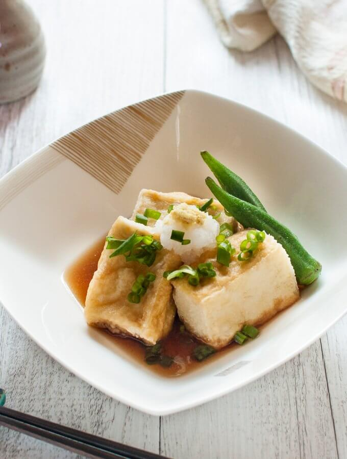 Agedashi Tofu (or Agedashi Dofu) is one of the a-la-carte dishes you always find on the menu at Japanese restaurants. It is delicate and simple but so yummy. The sweet soy sauce-based dashi goes so well with deep fried tofu.