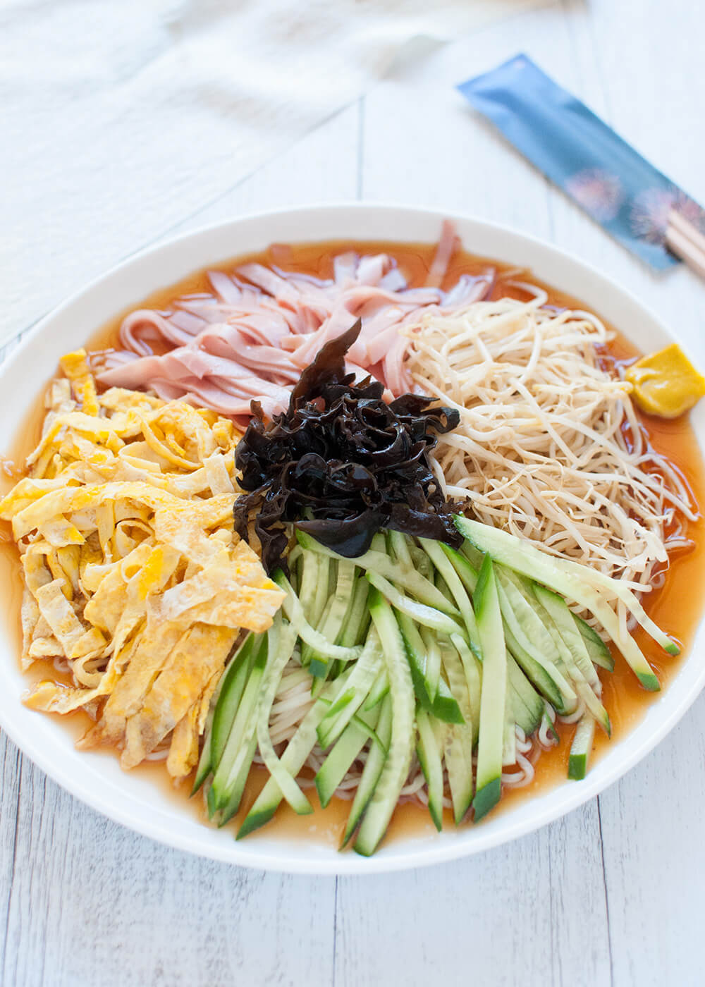 Hiyashi chka cold ramen recipetin japan hiyashi chka is made with cold chinese style egg noodles with sweet vinegar sauce and topped with vegetables egg and ham it is a great dish to have on a forumfinder Gallery