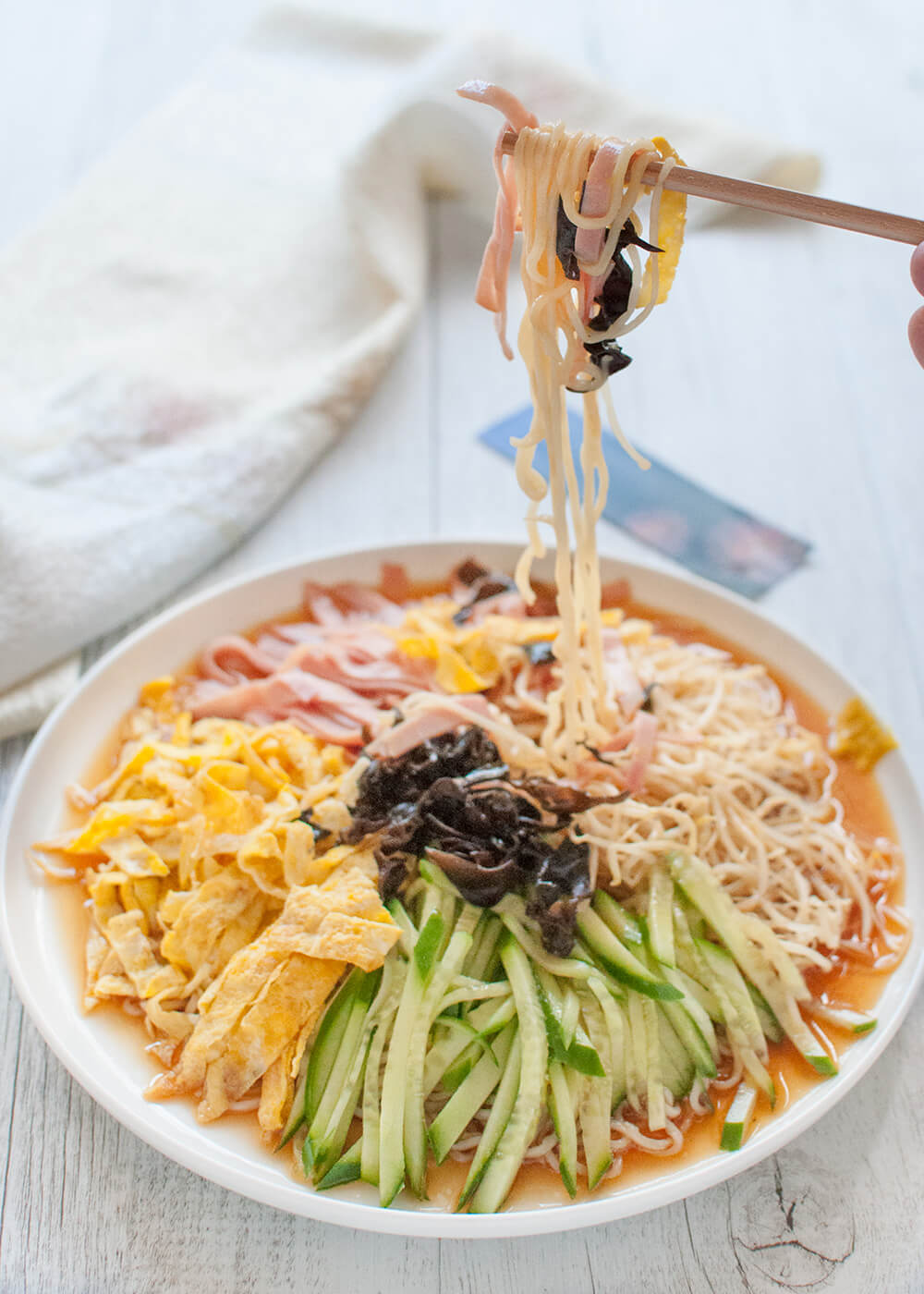 Hiyashi chūka is made with cold Chinese-style egg noodles, with sweet vinegar sauce and topped with vegetables, egg and ham. It is a great dish to have on a hot summer day.