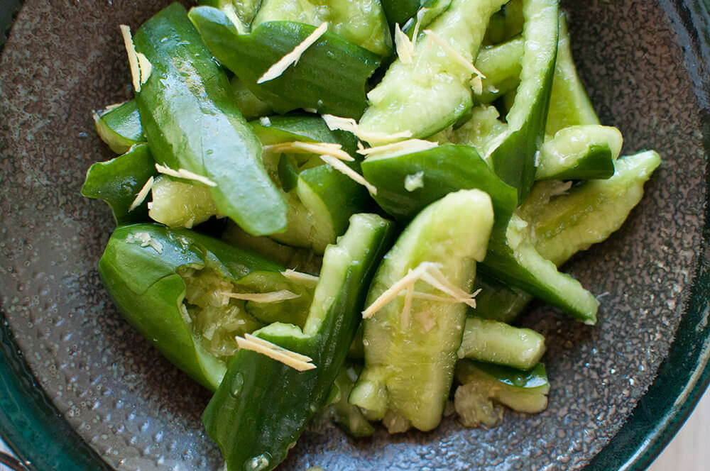 Tataki kyuri is a simple but unique cucumber salad. By smashing the cucumbers, the dressing penetrates into each piece. Ginger and soy sauce in the dressing gives this salad a Japanese touch.