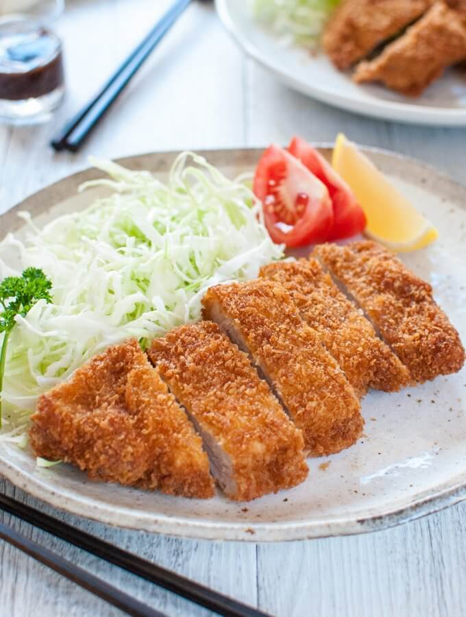 Breaded, deep fried crispy pork cutlet is one of the top 10 favourite dishes among Japanese people. Quite easy to make and served with a sweet fruity sauce, it is so delicious. Tonkatsu is also the main ingredient in Katsudon.