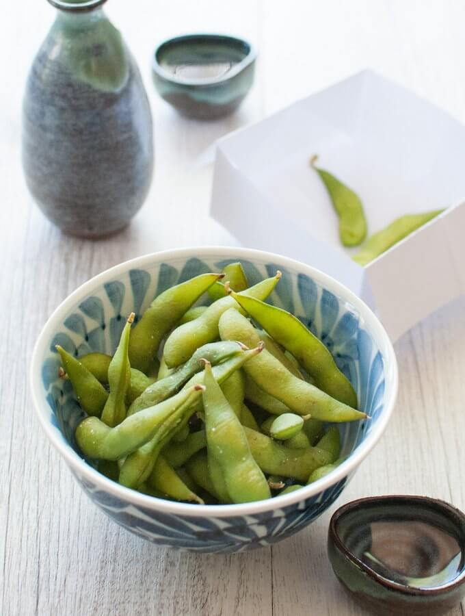 Edamame is served at Japanese restaurants but you can make it easily at home and it's much cheaper. Perfect snack for a crowd. It goes very well with drinks, particularly beer, but I don't mind any drinks with edamame.