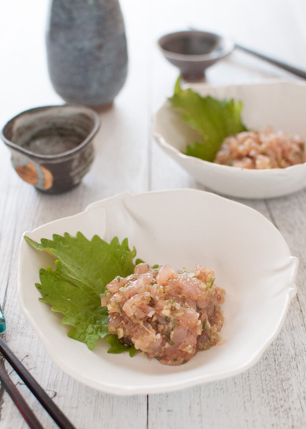 Japanese-style kingfish tartare, called Kingfish Tataki, is a similar dish to fish tartare but with miso flavour. The fish is chopped much more finely than standard fish tartare. Everything is done on a cutting board with a knife, including mixing the ingredients.