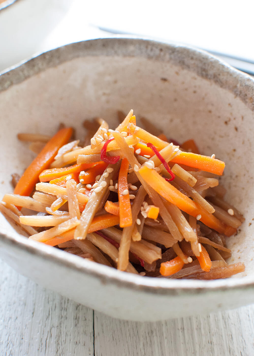 A typical Japanese home cooking dish, Braised Burdock (Kinpira Gobō) is a vegetable side dish. Burdock root and carrot are cut into matchsticks and cooked in a slightly sweet soy sauce. It is very fast to make and can be made ahead of time.