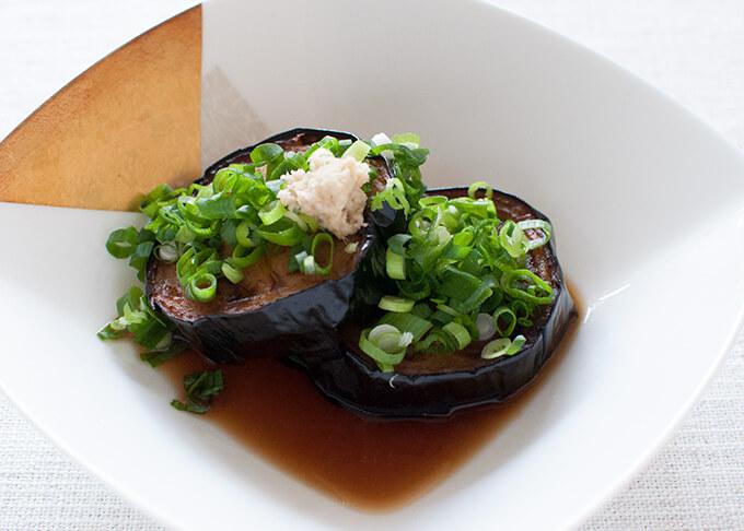 Deep fried eggplant made with large eggplant - disc shaped agedashi nasu.