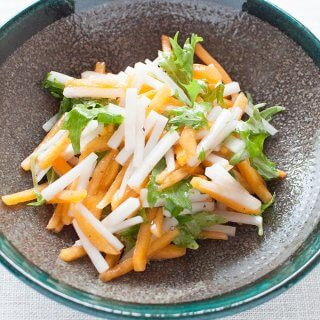 Persimmon and Diakon Salad with mizuna to add green colour to the salad.
