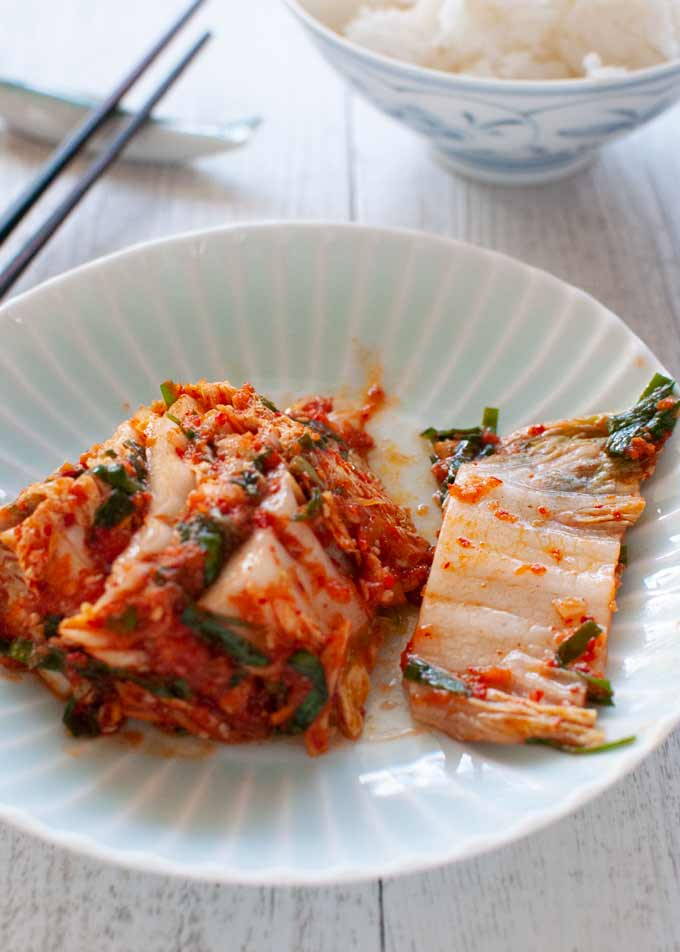 Kimchi served on a plate as a side.