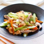 Chicken Stir Fry with Celery, Carrot and Cashew served on a black plate.