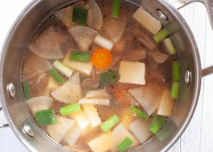 Kenchin Jiru (Japanese Vegetable Soup) being cooked in a saucepan.
