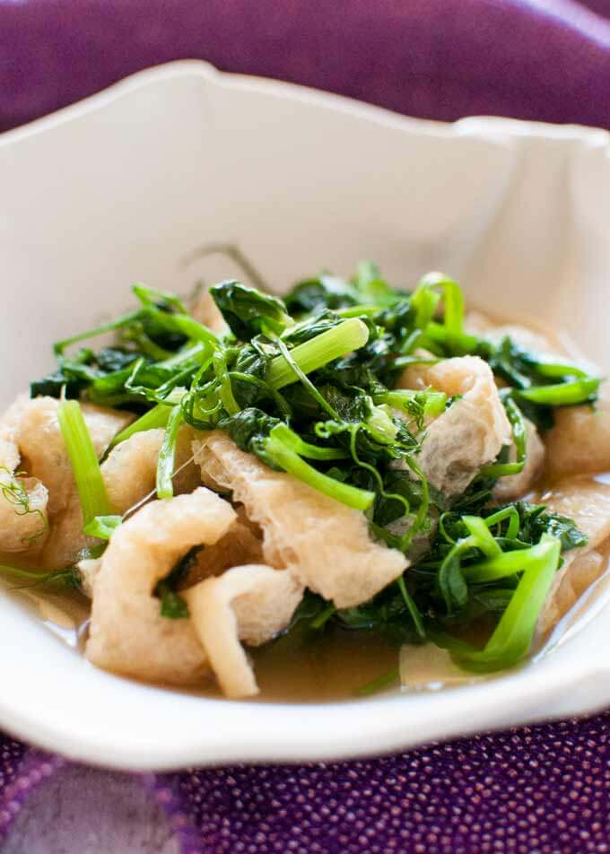Snow Pea Leaves Warm Salad in a bowl..