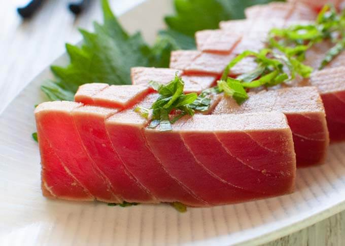 Zoomed-in photo of Marinated Tuna Sashimi .