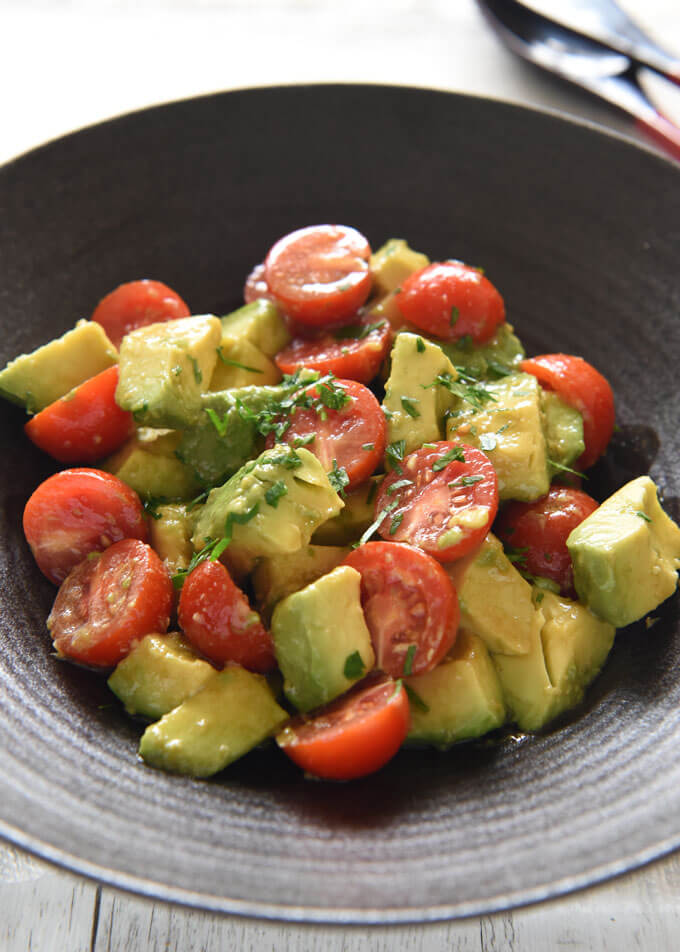 Avocado and tomato salad with Wasabi Dressing.
