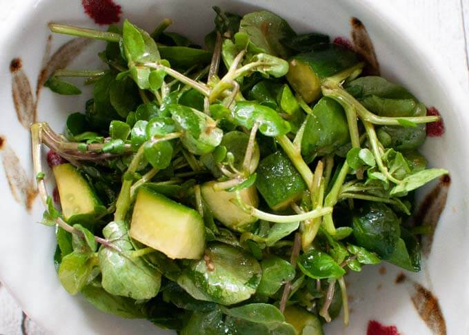 Zoomed in photo of Watercress Salad dressed in Wasabi Dressing.