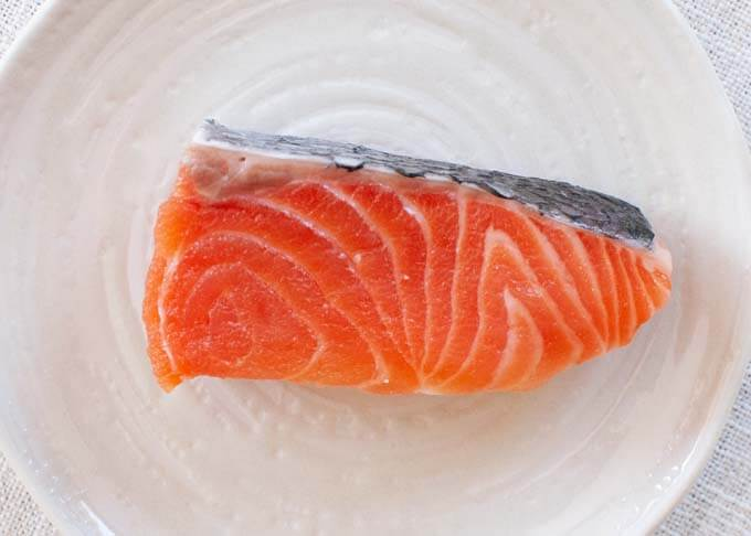 Fresh salmon fillet cut to a small size that suits in a bento box.