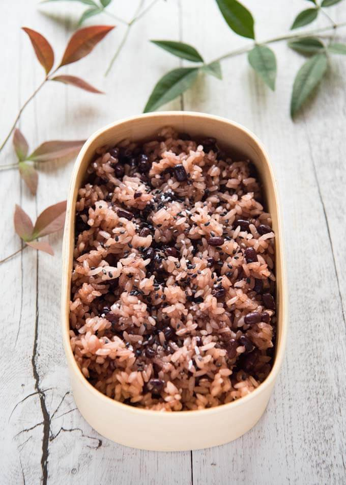Hero shot of Azuki Bean Rice (Osekihan) in a wooden container.