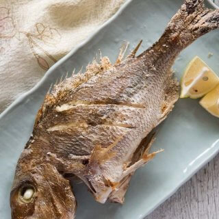 Hero shot of Grilled Whole Snapper served on. plate.