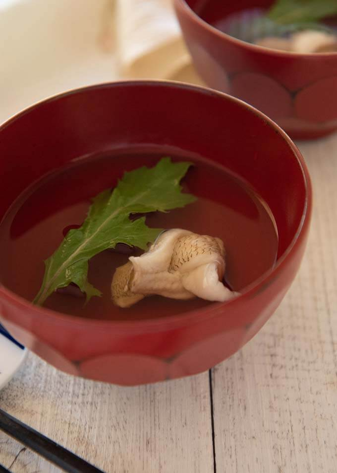 Japanese Clear Soup with Whiting in a red soup bowl.