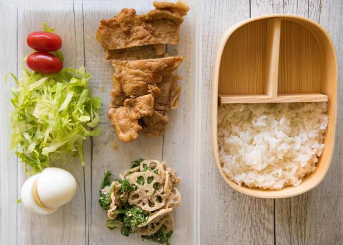 Ingredients to make up of Pork Shōgayaki Bento - Pork Shōgayaki, small tomatoes, boiled eggs on shredded lettuce and Lotus Root and Spinach salad.
