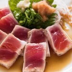 Hero shot of Tuna Tataki with Ponzu Dressing and condiments.