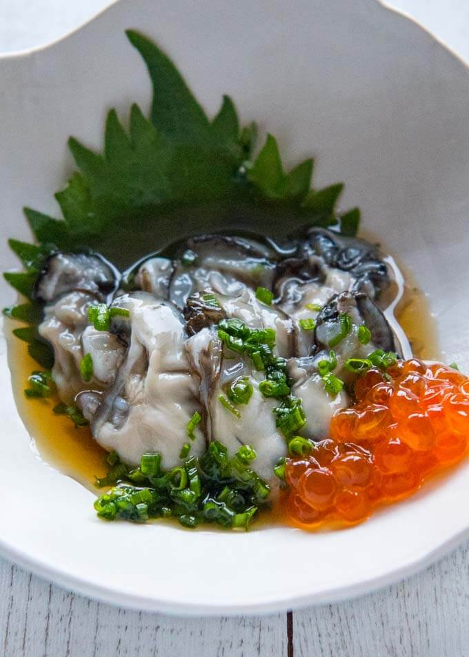 Serving Oysters with Tosazu Dressing in a bowl without shells.