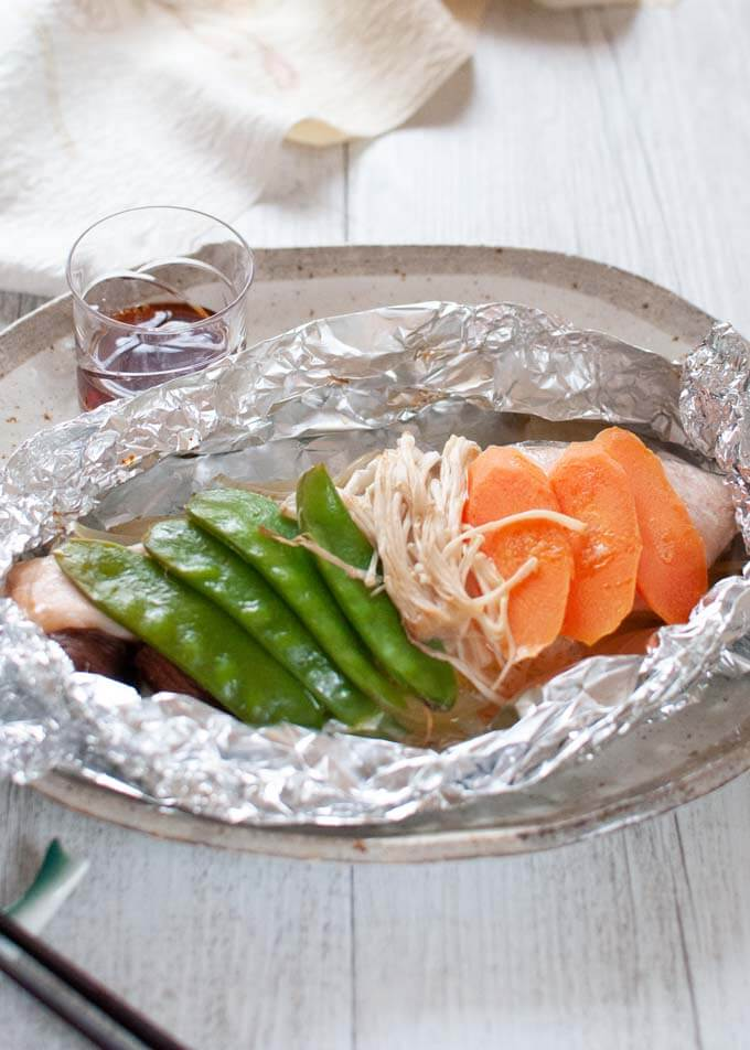 Hero shot of Salmon in Foil with Ponzu Dressing on side.