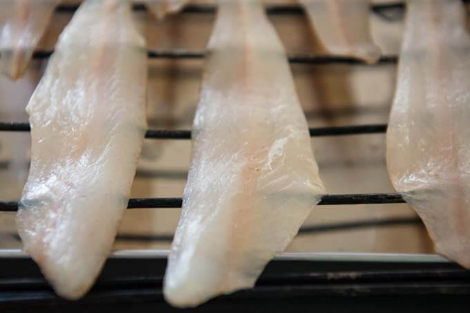 Zoomed in photo of whiting fillet on a rack.