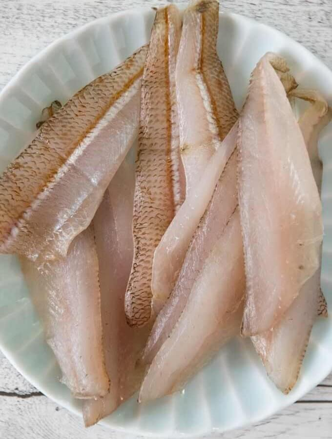 Semi-dried Whiting Fillets on a plate.