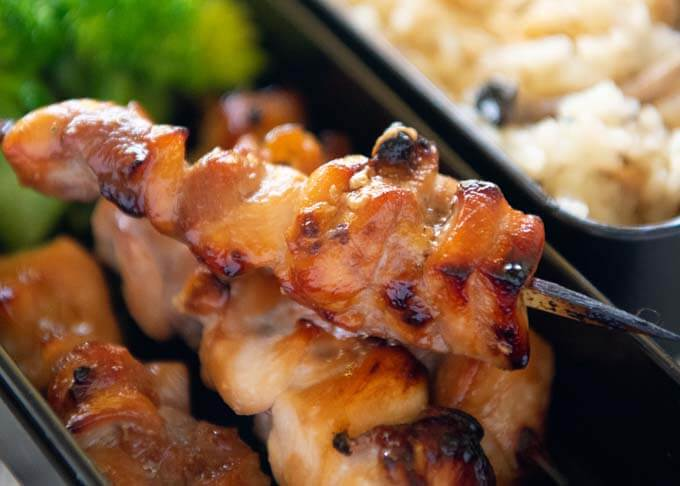 Zoomed-in photo of Yakitori in a bento box.