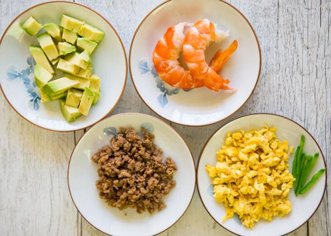 Inarizushi toppings - prawn & avocado, seasoned mince & ire tamagotchi's.