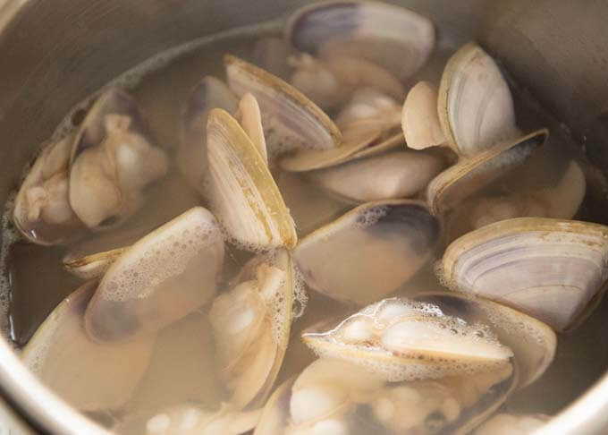Clams being cooked in a pot.