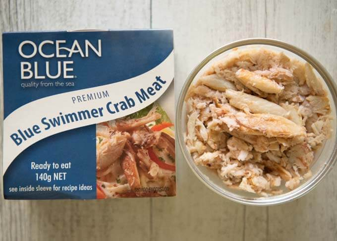 Store-bought cooked blue swimmer crab meat in a tab.