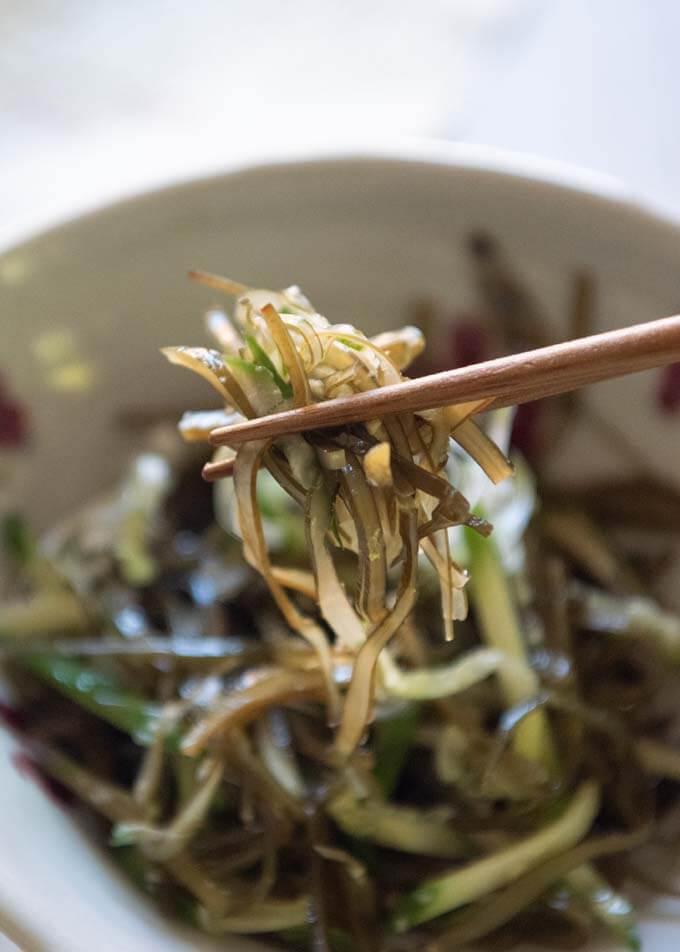 Photo of picking up some shredded konbu from Konbu Seaweed and Cucumber Salad.