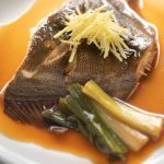 Simmered flounder on a plate.