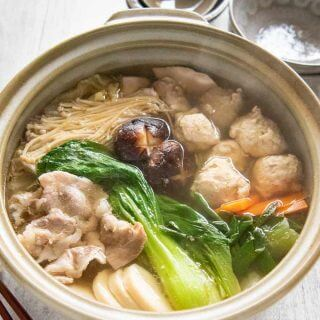 Hero shot of Chanko Nabe cooked in a large clay pot.