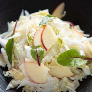 Hero shot of Chinese Cabbage and Apple Salad on a serving bowl.
