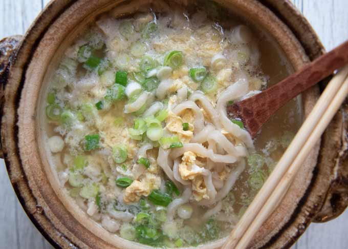 Udon noodles with egg and chopped shallots with the broth leftover from Chanko Nabe.