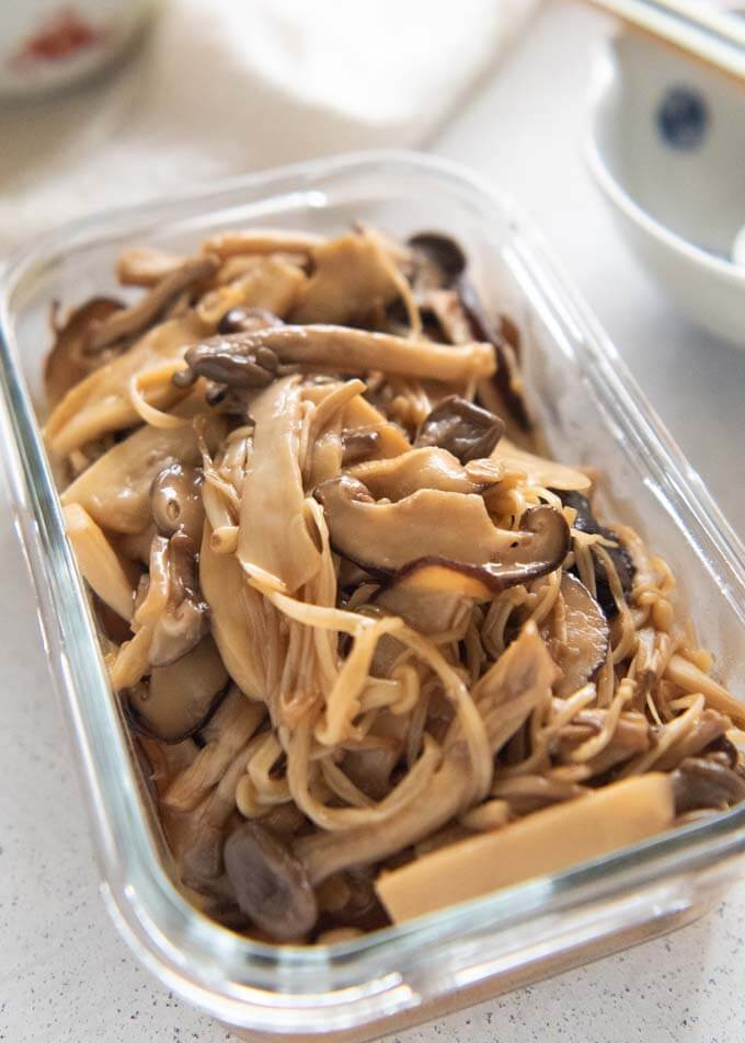 Hero shot of Easy Marinated Mushrooms in a glass container.
